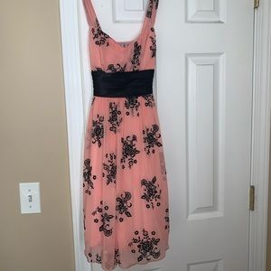 Pink dress with black flowered design.